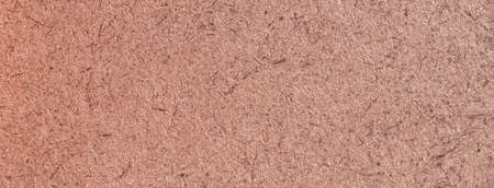 A close up of a brown fibreboard background. High quality photo