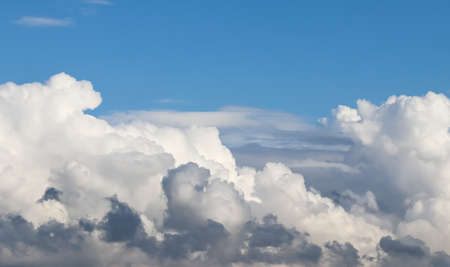 Background of blue sky with beautiful natural white clouds. Standard-Bild