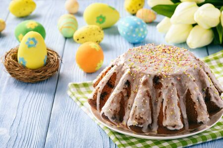 Easter cake on easter festive table. Copy space.