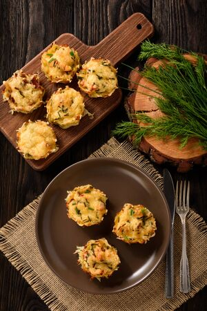 Appetizer - potato muffins with chicken meat and cheese. Stock Photo