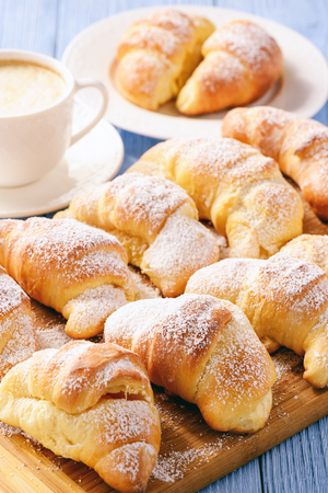 Homemade sweet croissants stuffed with cheese. 版權商用圖片