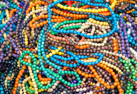 The variety of wooden colorful beads. Stock Photo