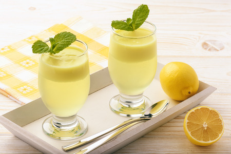 jello: Lemon jelly with mousse on white tray.