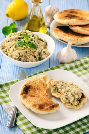 Traditional greek eggplant spread (dip) with pita bread. Stock Photo - 73025937