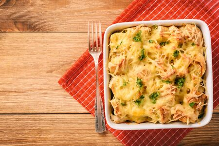 Bread casserole with chicken, spinach, eggs and cheese known as strata.