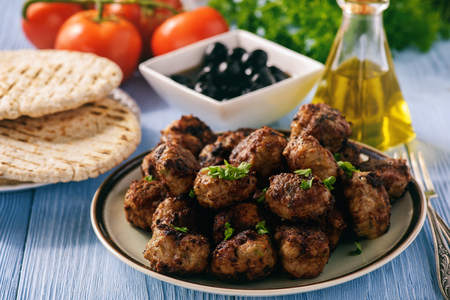 Greek meatballs (keftedes) with pita bread and tzatziki dip.