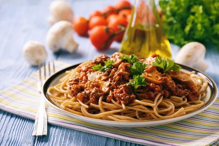 Wholegrain spaghetti with homemade bolognese sauce and mushrooms.