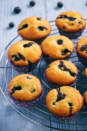 blueberry muffin: Homemade blueberry muffins on a wooden background.