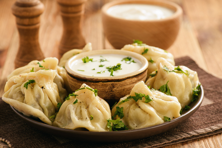 Khinkali - traditional georgian dumplings stuffed with meat. Stock Photo