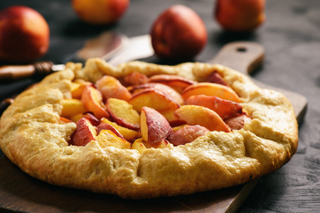 Homemade rustic galette with peaches. Banco de Imagens