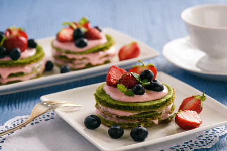 Homemade spinach cake with strawberry mousse 写真素材