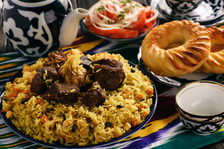 Pilaf - traditional asian dish, rice prepared with vegetables and meat. Oriental, uzbek style.