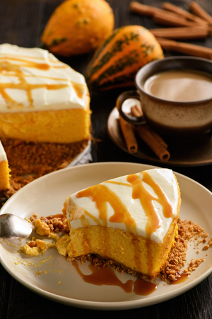 Homemade delicious pumpkin cheesecake with caramel sauce.