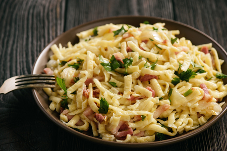 Spaetzle with bacon and onion, german style cuisine