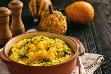 Risotto with pumpkin, cheese and parsley. Stock Photo