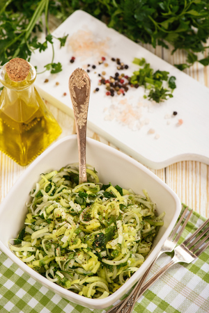Vegetarian raw salad with leek, parsley, dill and olive oil.