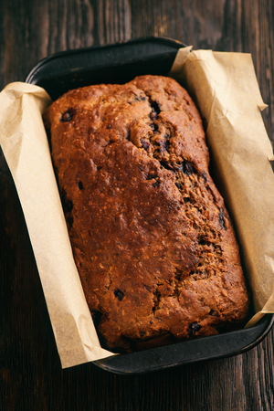 Homemade banana bread loaf with blueberries.