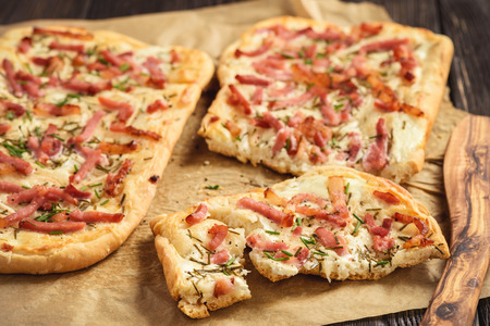Tarte flambee, traditional alsatian pizza. Stock Photo