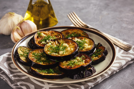 Fried eggplants with garlic and dill.