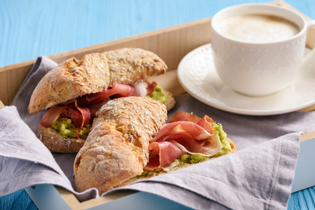 Sandwiches with ham and avocade spread.