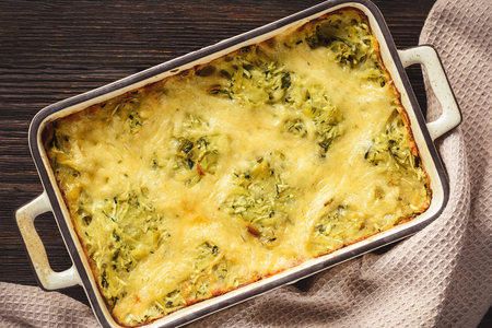 Zucchini and potato casserole with cheese, vegetarian food.