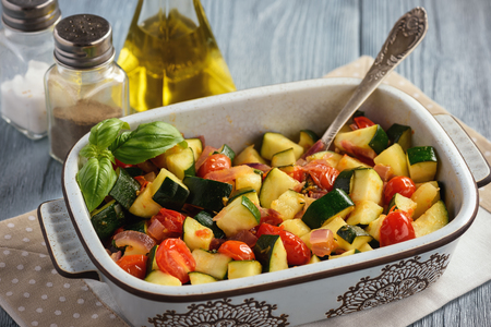 Sauteed zucchini with tomatoes and red onion.