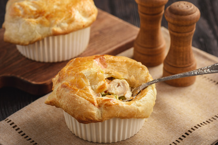 Chicken pot pie with carrot, greas peas and cheese.
