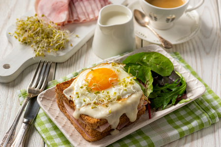Croque madame, hot french toasts with ham, cheese and egg.