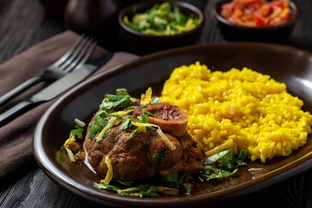 Braised veal shank, ossobuco, served with risotto and gremolata