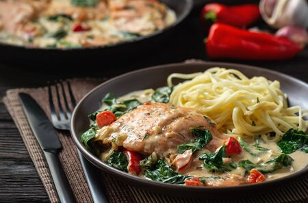 Salmon baked in cream sauce with spinach and bel pepper.