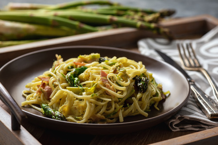 Homemade pasta with bacon, parmesan and asparagus. 写真素材
