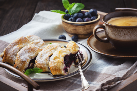 Homemade blueberry strudel, on wooden tray. 写真素材