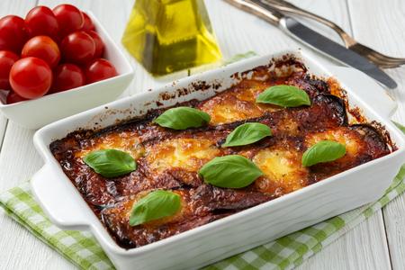 Eggplant casserole with parmesan, melanzane alla parmigiana, italian cuisine.