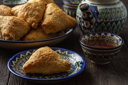 Puff pastries with meat (samosa) - traditional uzbek and indian pasrty. Stock Photo