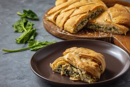 Homemade savory braided puff pastry with spinach and ricotta filling.