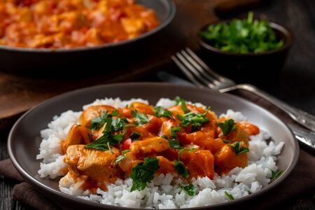 Chicken goulash served with boiled rice.