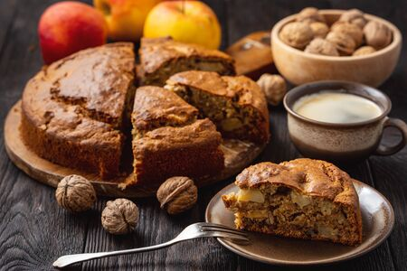 Homemade banana cake with apples and walnuts