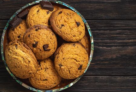 Homemade chocolate chips butter cookies, on wooden background. Stock Photo