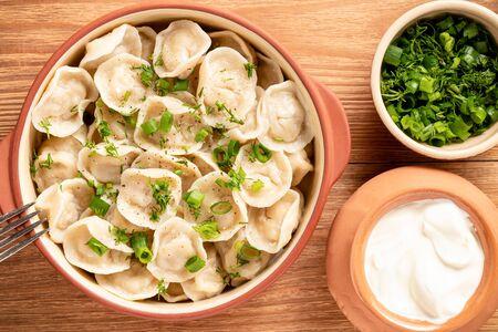 Meat filled dumplings, pelmeni, Russian cuisine.