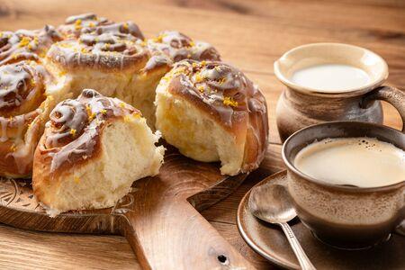 Homemade lemon sweet swirl buns, on wooden Stock Photo