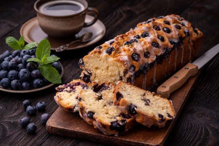Homemade blueberry cake and cup of coffee.