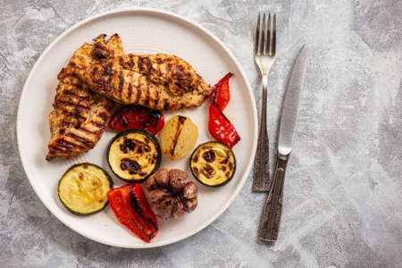 Grilled chicken breasts and vegetables.