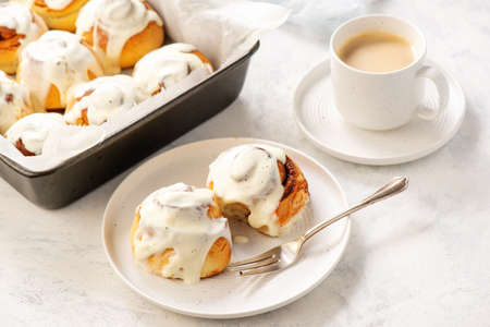 Homemade cinnamon buns with cream cheese icing.