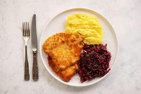 Chop pork cutlets, served with mashed potatoes and beetroot salad.