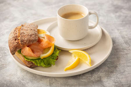Sandwiches with smoked salmon, salad, cucumbers and eggs. Stock Photo