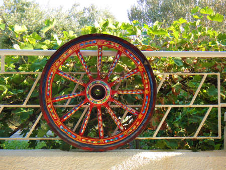 multicolor old horse carriage wheel