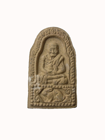 small group of objects: Thai Buddhist amulet