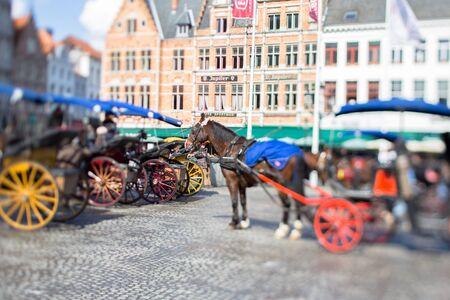 bruges: A surrey in the square of Bruges in Belgium Editorial