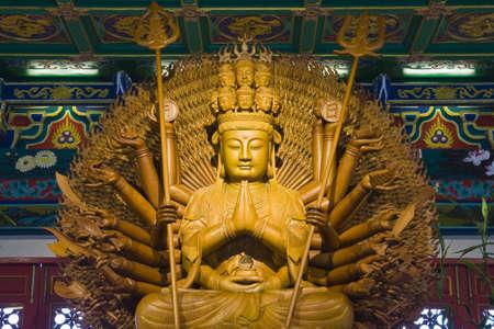 teak: idol engrave from teak at chinese temple at bangbuatong nonthaburi