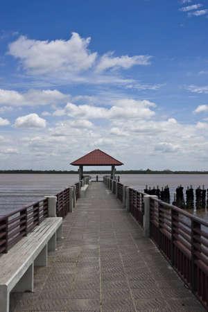 walk way to riverside at thai gulf under blue sky